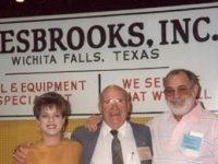 Marshall Hamilton of Hamilton Tires with Lori Wesbrooks Stone and Bob Wesbrooks at the 1993 NTDRA Tire Show in Orlando.
