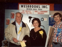Mike Grauerholz of Wesbrooks, Inc. presenting a rifle at the 1992 NAIL Quick Lube Show in New Orleans.