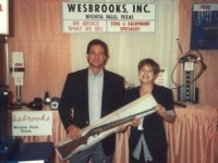 Lori Wesbrooks Stone with the lucky winner of a shotgun at the 1992 CASI Quick Lube Show in West Palm Beach.