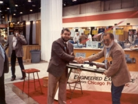 Bob Wesbrooks presents a rifle to a customer at the 1990 NATSO Truck Stop Show in Las Vegas.