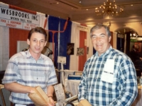 Ed Kuhn, President and CEO of TravelCenters of America and a friend stop by the Wesbrooks booth for some peanuts at the TA Trade Show in Nashville in 1995. Ed is our best peanut customer!