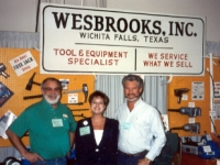 Bob Wesbrooks, daughter Lori, and Dave Latimer, Petro Lube Operations Manager, at the NTDRA Tire Show in Las Vegas in 1992.